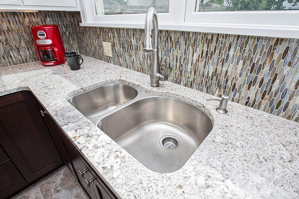 A stainless steel sink in this Hyde Park kitchen remodel.
