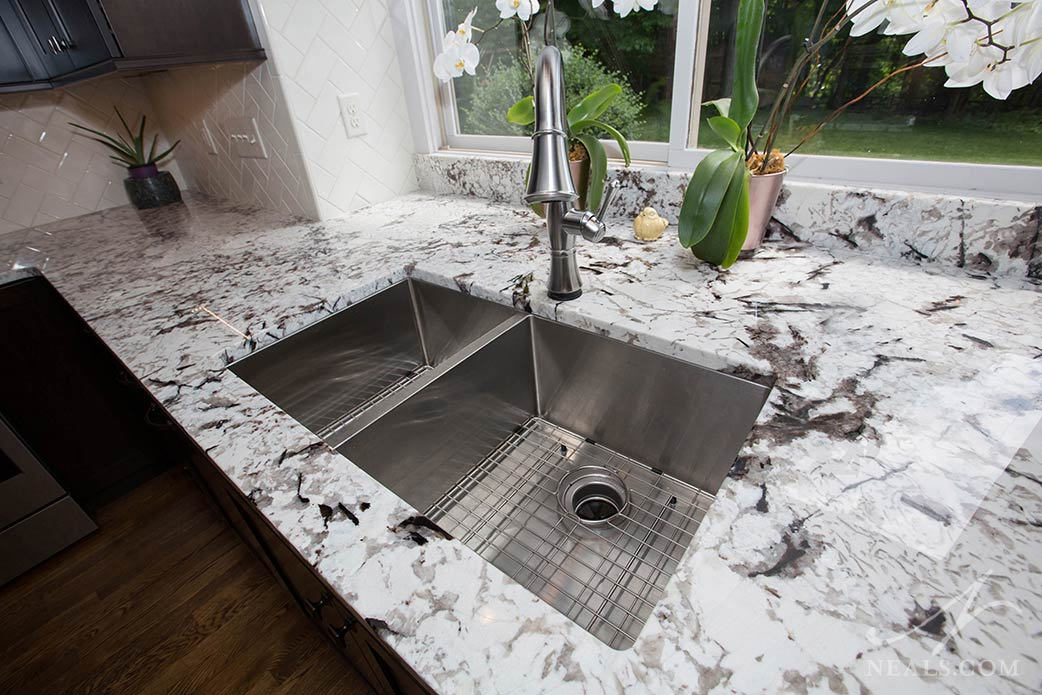 A double bowl sink with modern square corners in this Loveland kitchen.