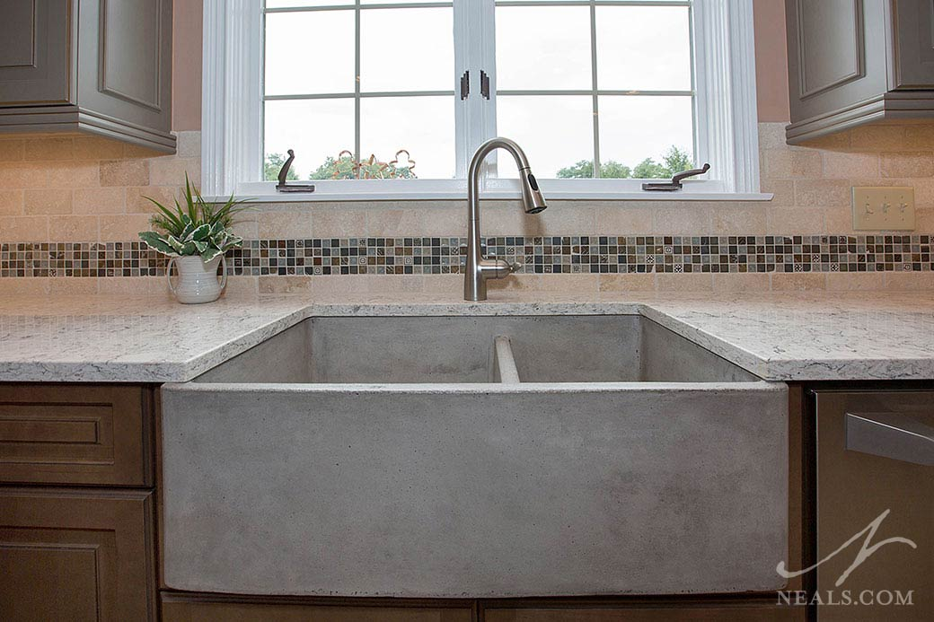 A concrete-look fireclay sink in this Maineville kitchen.