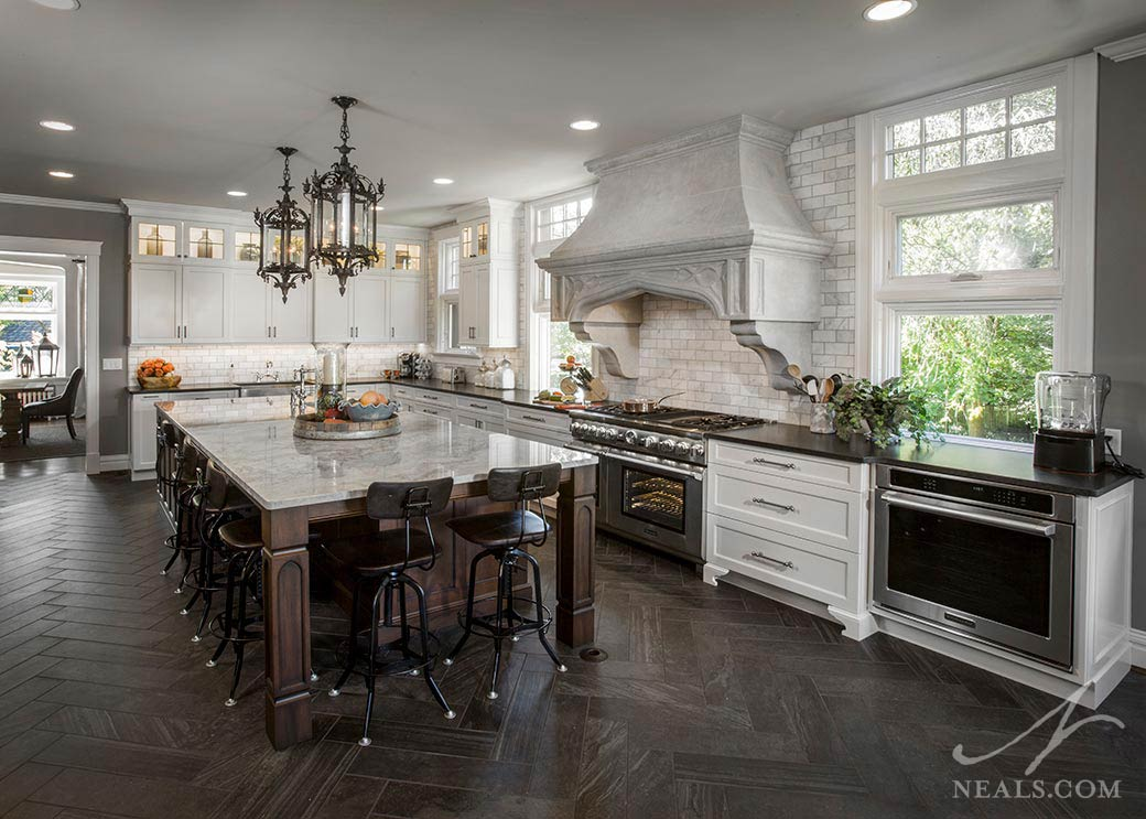kitchen with cast stone range hood