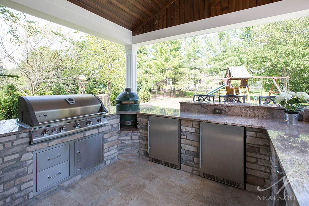 Granite counters and stone housing is a Midwest outdoor kitchen standard.