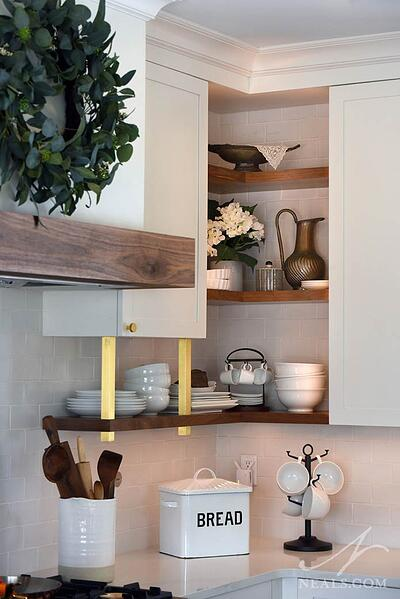 open shelving in the corner of kitchen