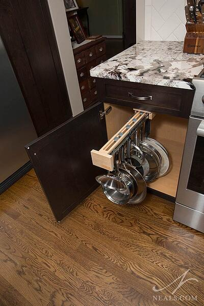 A slide-out rack for pans in this Loveland remodel makes storage easy and convenient.