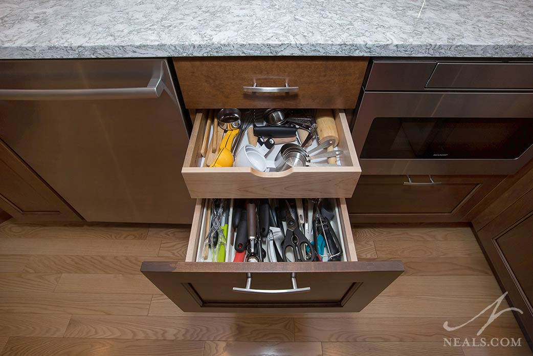 A drawer tray slides back to reveal even more storage capacity in this Montgomery kitchen.
