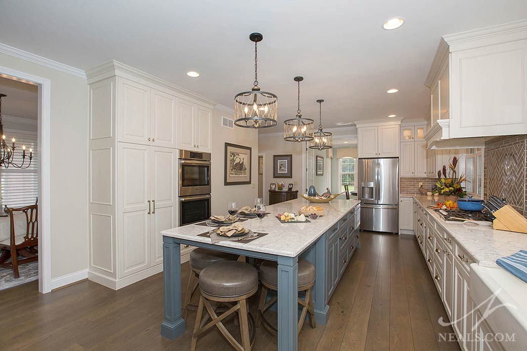 With cabinets on both sides and a seating area, the island in this Withamsville project doubles the kitchen function.