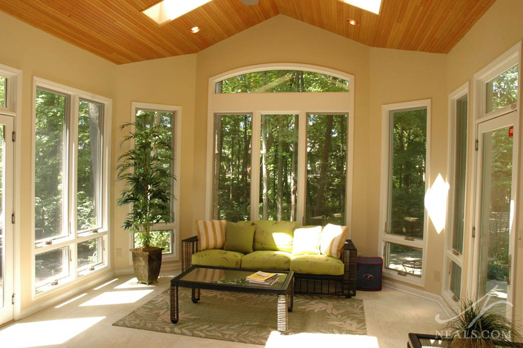 The windows of this Loveland three-season sunroom are awning windows that can be opened for some fresh air.