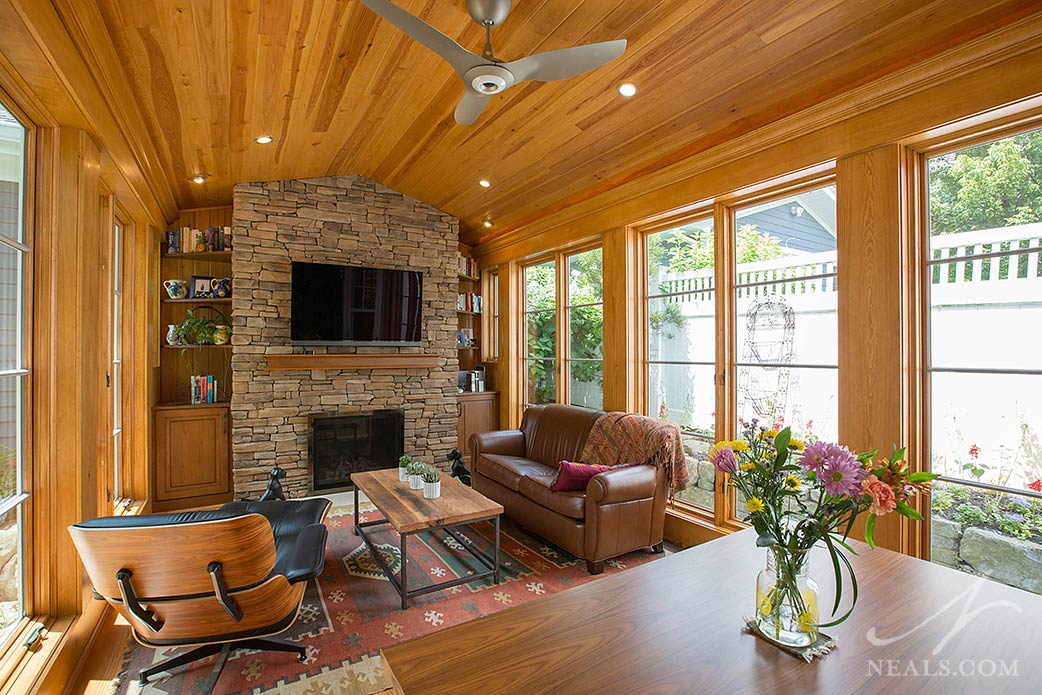 A fireplace at the end of this Montgomery sunroom creates a cozy atmosphere for both relaxing alone or socializing with guests.
