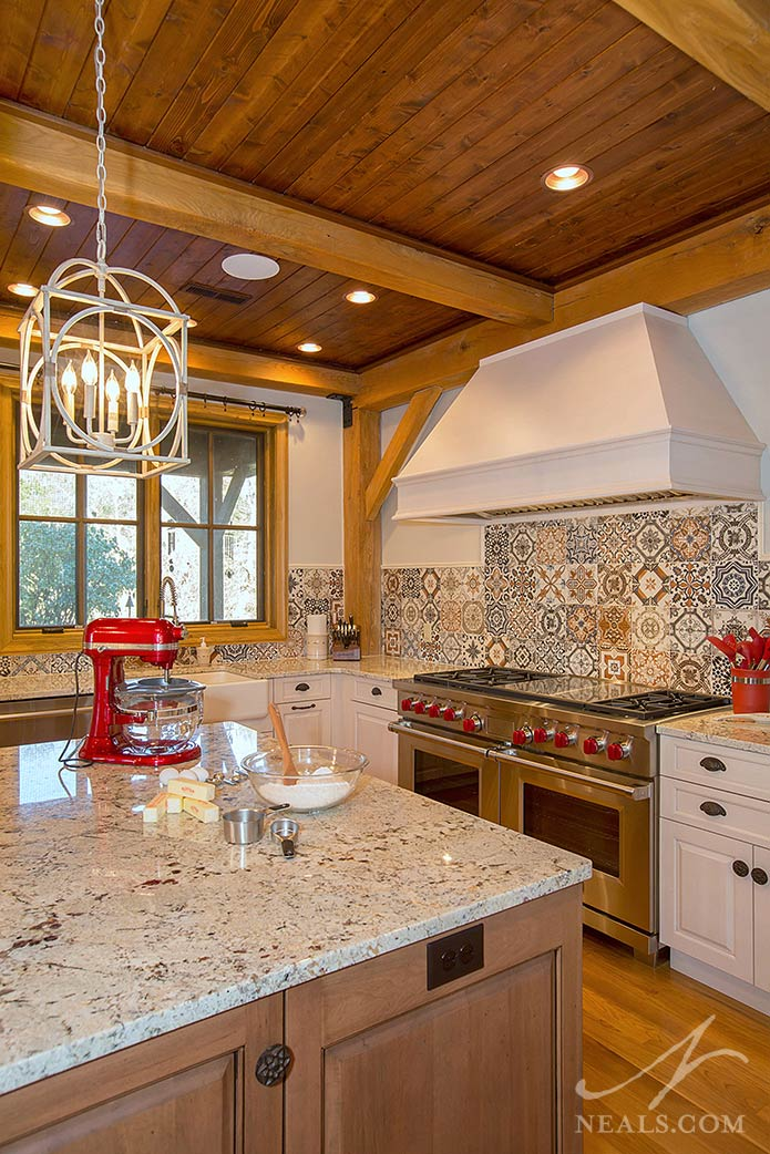 A custom vent hood preserves the ceiling in this Middletown kitchen remodel.