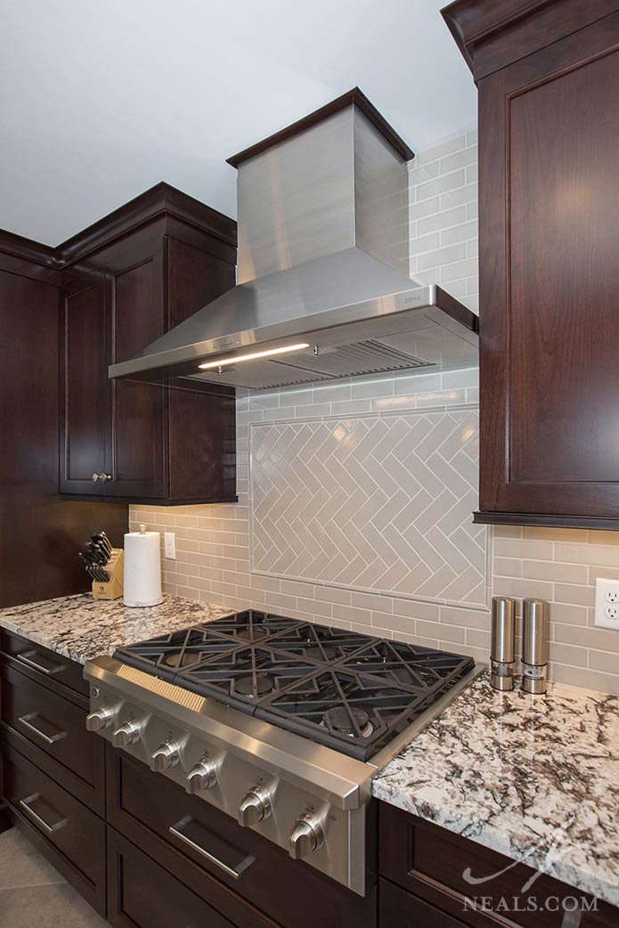 A substantial industrial pre-made hood in this Mason kitchen remodel.
