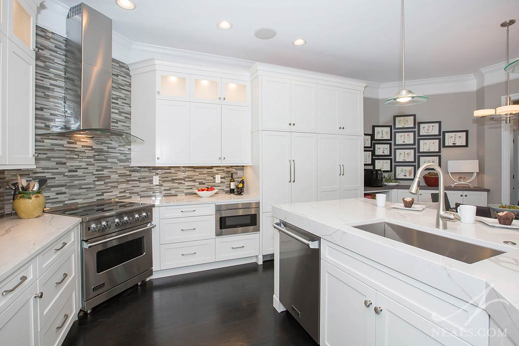 white contemporary kitchen with range, dishwasher and microwave drawer