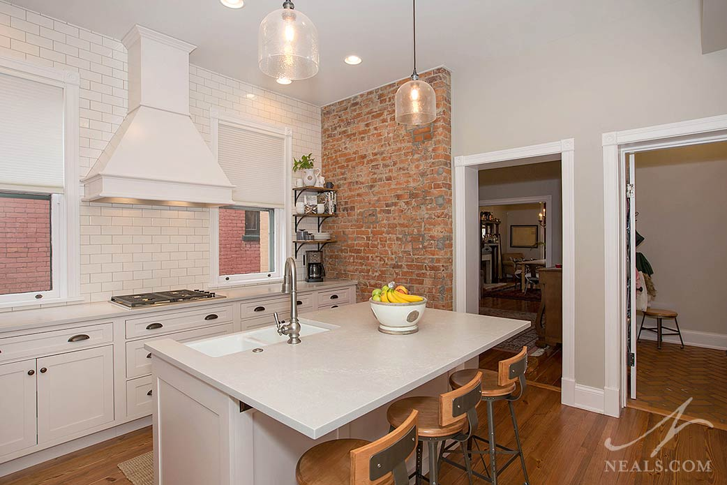 original brick wall in old home kitchen remodel