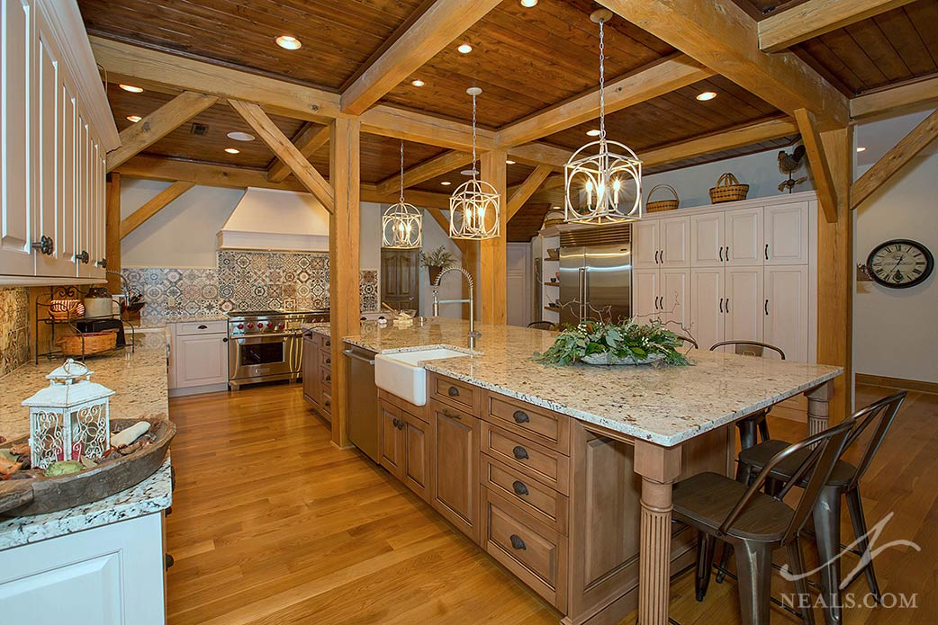 Rustic kitchen with traditional details, large island and multiple work areas.