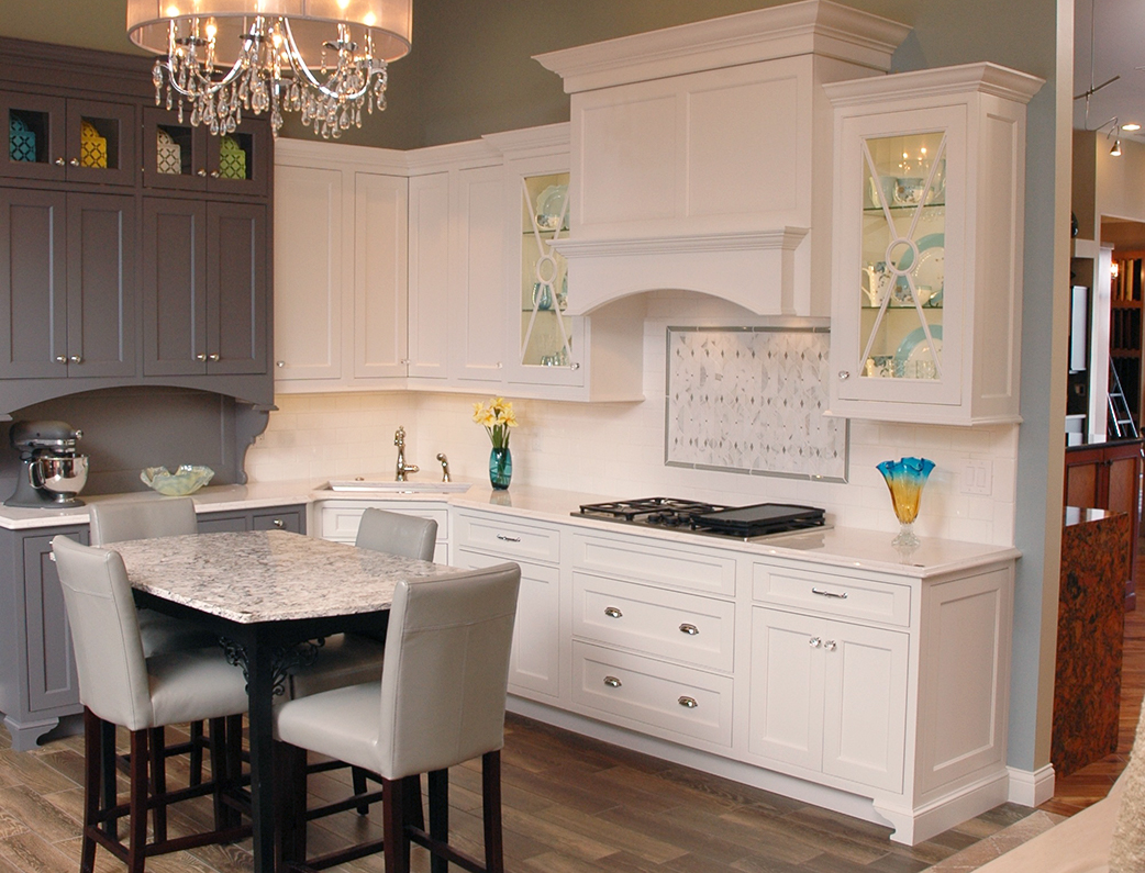 Our Cincinnati Design Showroom is full of inspiring examples like this white traditional kitchen.
