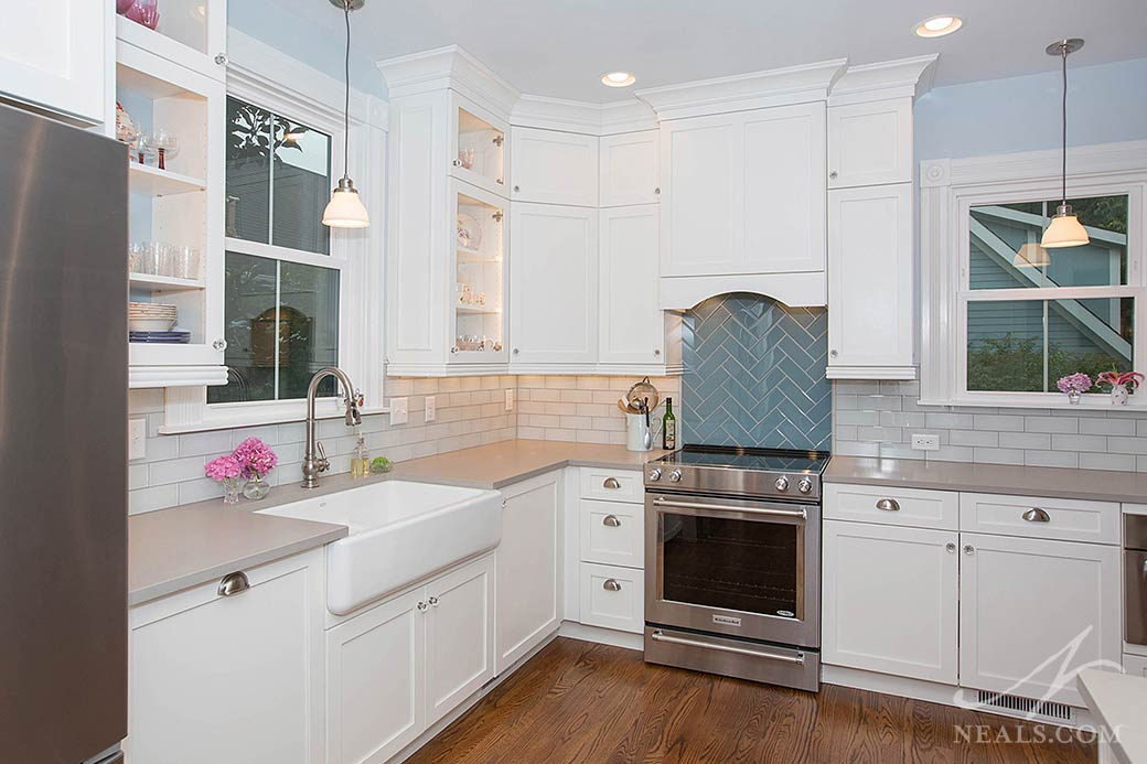traditional kitchen with glass-fronted wall cabinets