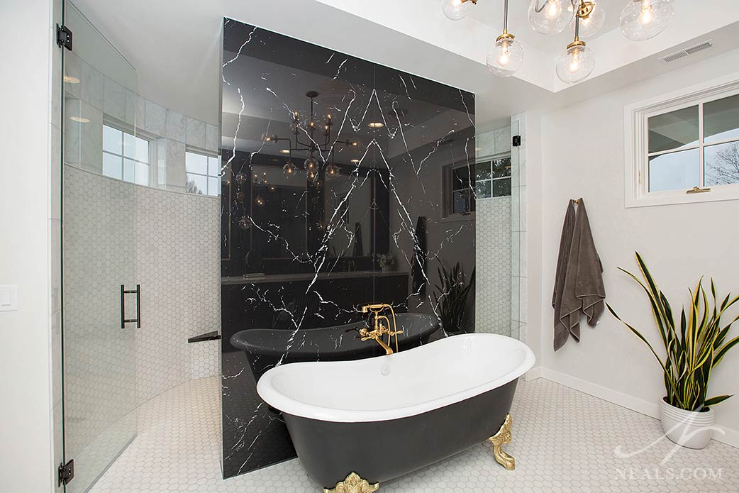 neolith slab wall with soaker tub