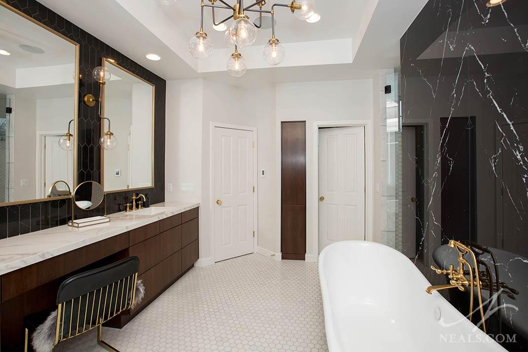 bathroom remodel with tub and vanity