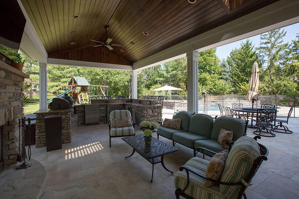 outdoor living with grill area and pool