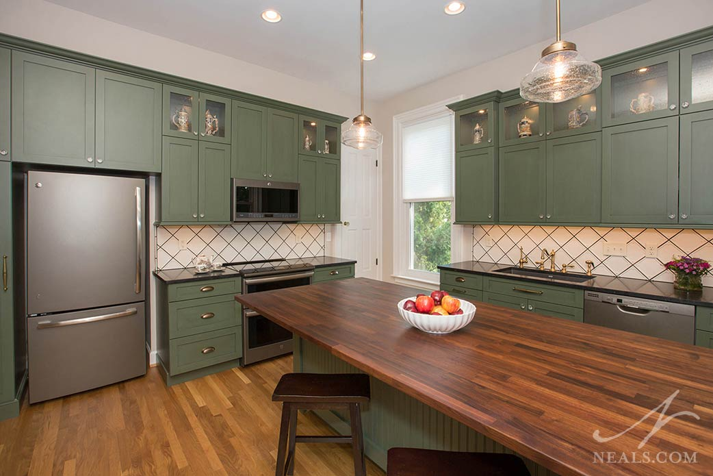 kitchen with green cabinetry